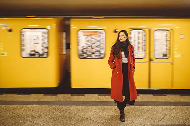 young woman in berlin subway station - kreuzberg stock-fotos und bilder