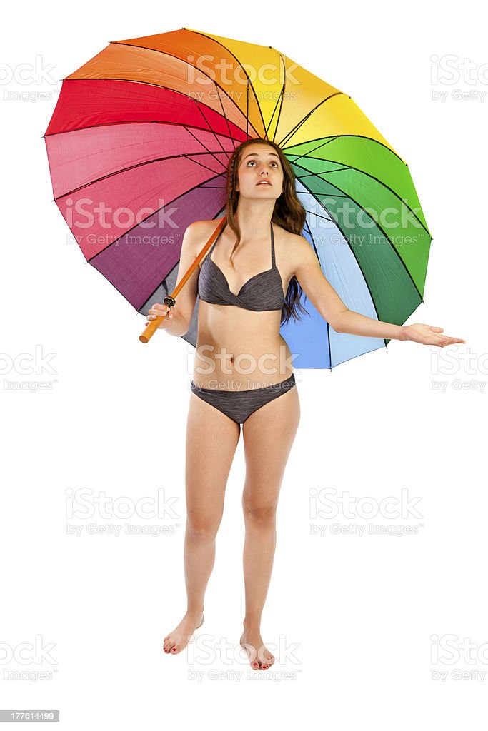 Young woman in bikini standing under umbrella. Raining? royalty-free stock photo