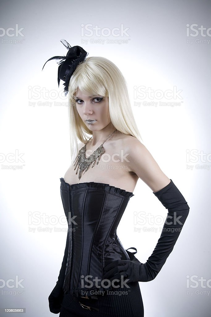 Young woman in black corset stock photo