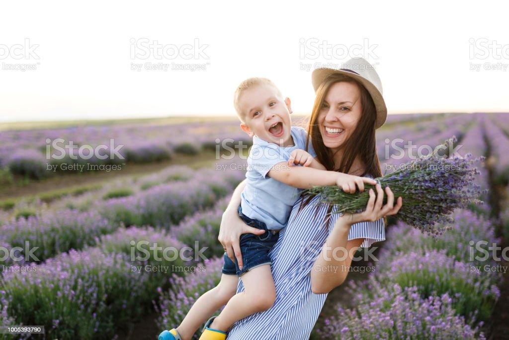 Young Woman In Blue Dress Hat Walk On Purple Lavender Flower Meadow