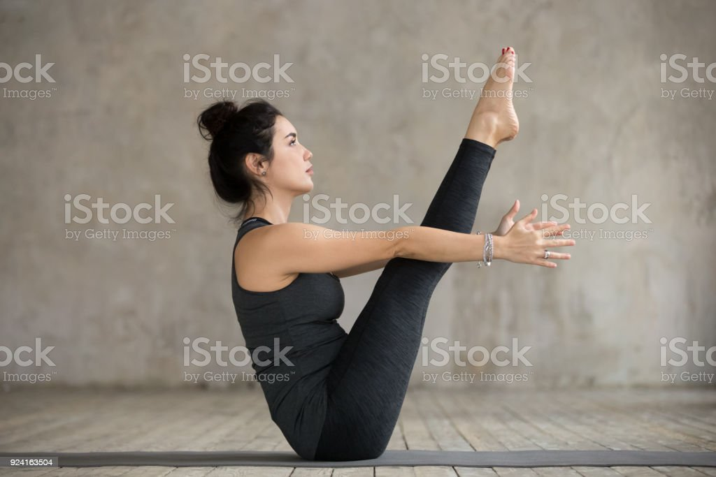 Young woman in boat pose stock photo