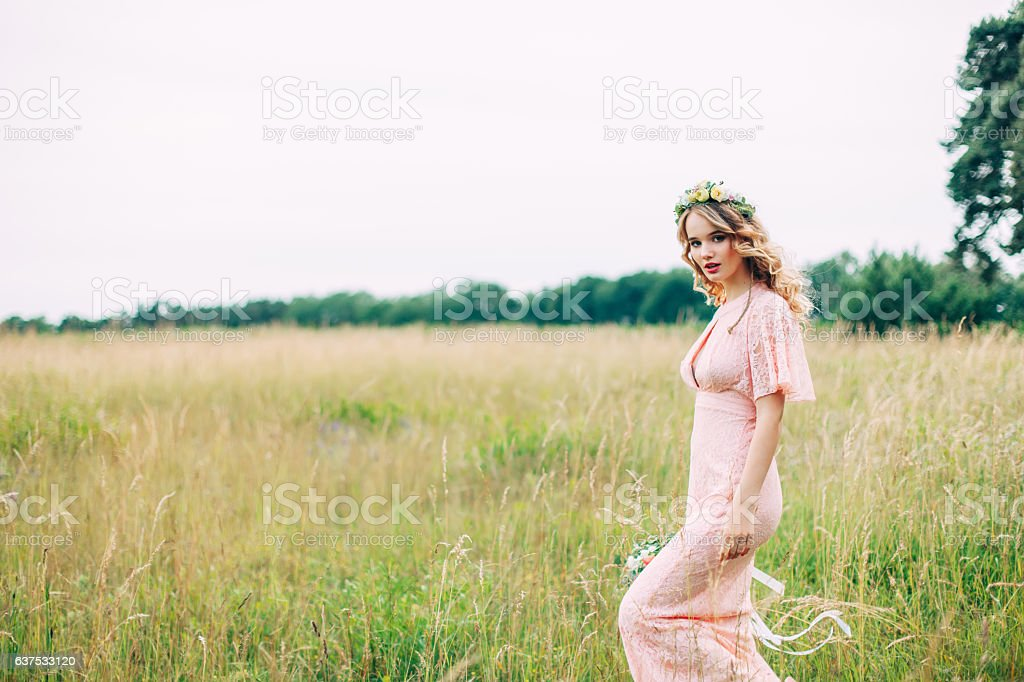 Young Woman In Boho Dress Standing On Meadow - foto de stock