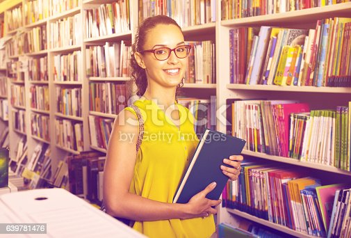 istock young woman in book shop 639781476