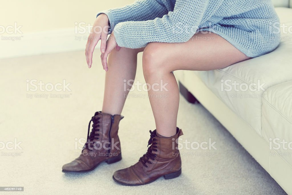 Young woman in brown ankle boots stock photo