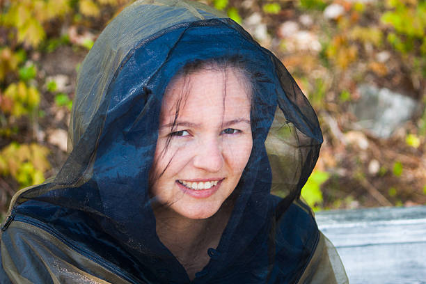 young woman in bug gear stock photo
