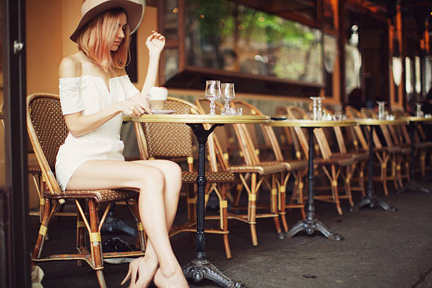 young woman in cafe - paris fashion stock photos and pictures