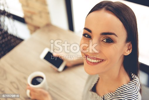istock Young woman in cafe 625529816