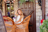 young woman in caffee looking aside