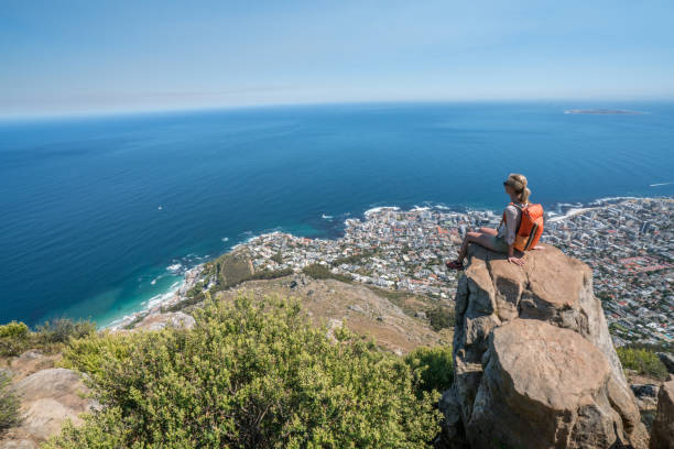 young woman in cape town on top of mountain looking at view - table mountain national park stock pictures, royalty-free photos & images