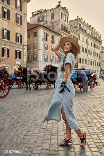 Italian vacation series. Young woman in casual dress enjoying evening in Rome