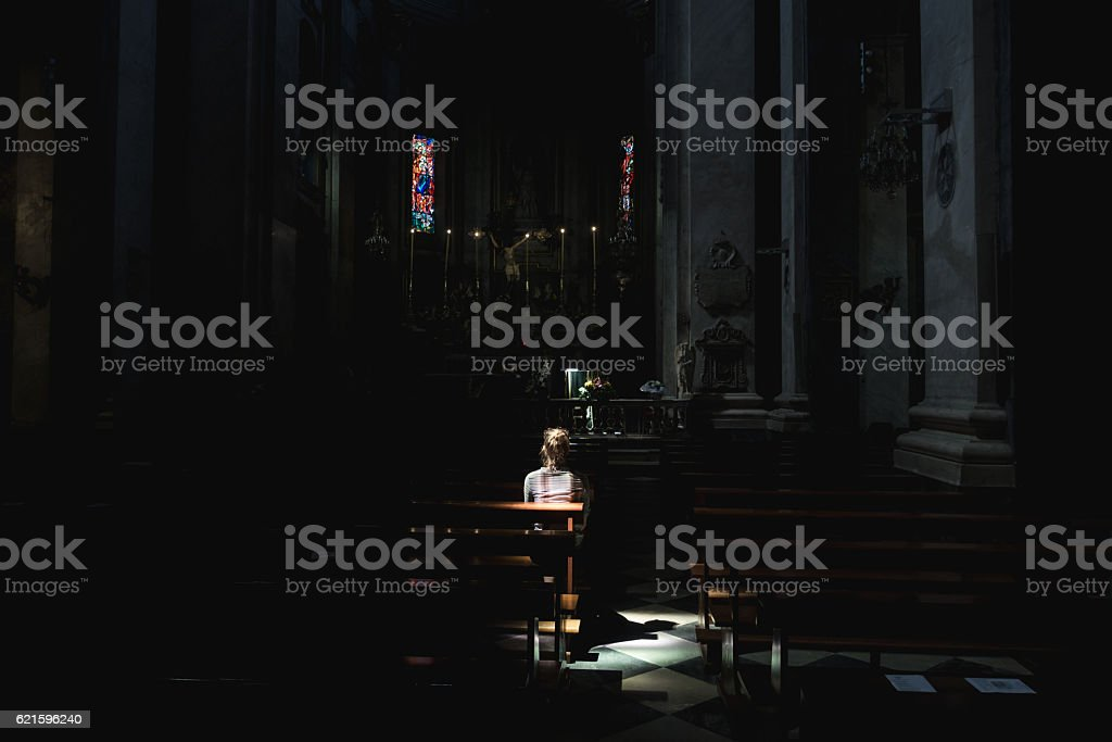 Young woman in church stock photo