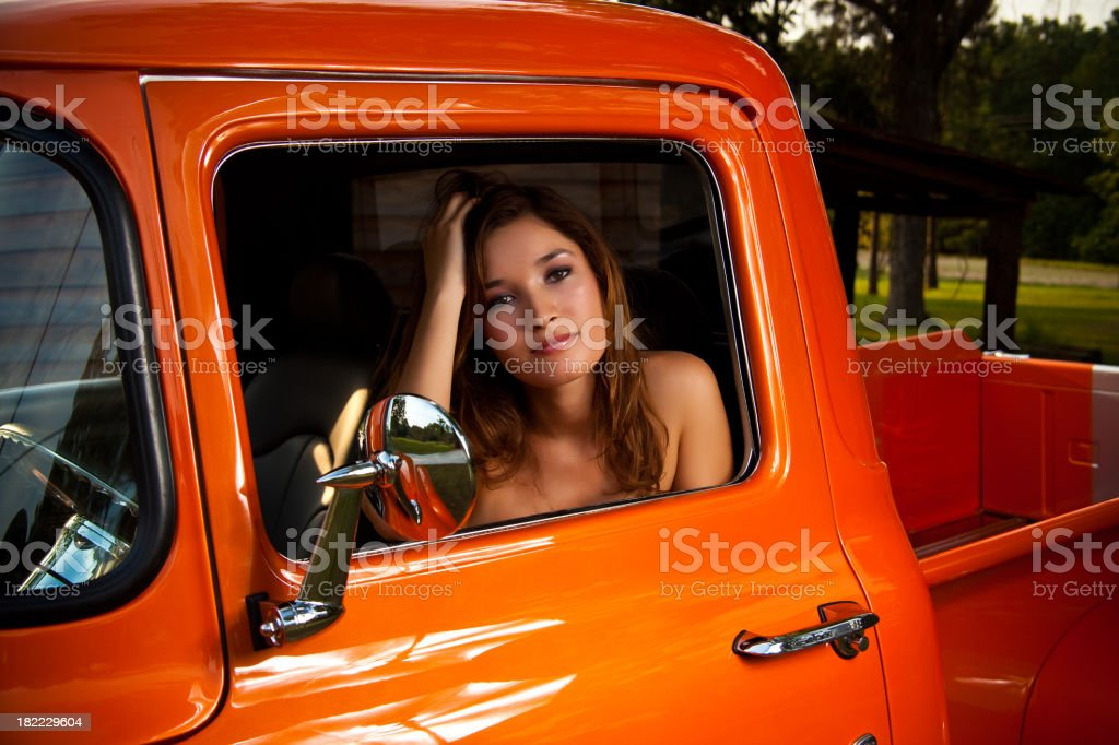 Young woman in classic truck royalty-free stock photo