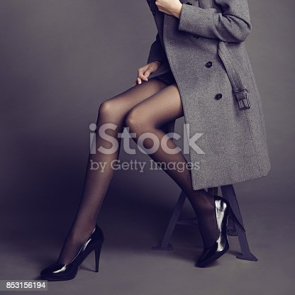 istock Young woman in coat with beautiful feet 853156194