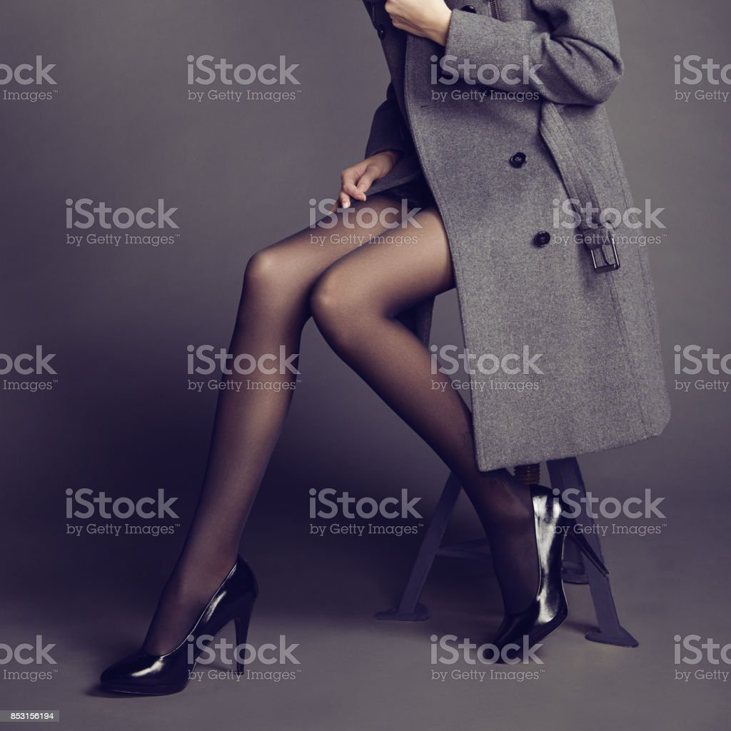 Young woman in coat with beautiful feet stock photo