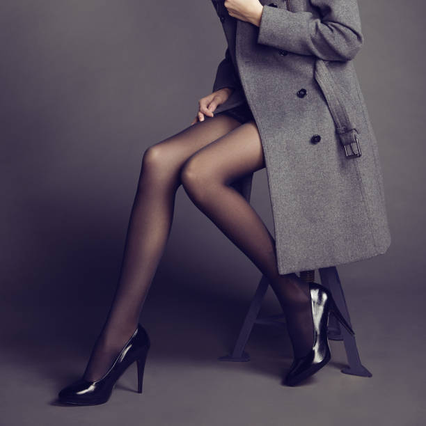 young woman in coat with beautiful feet - body parts of sexy girls stock pictures, royalty-free photos & images