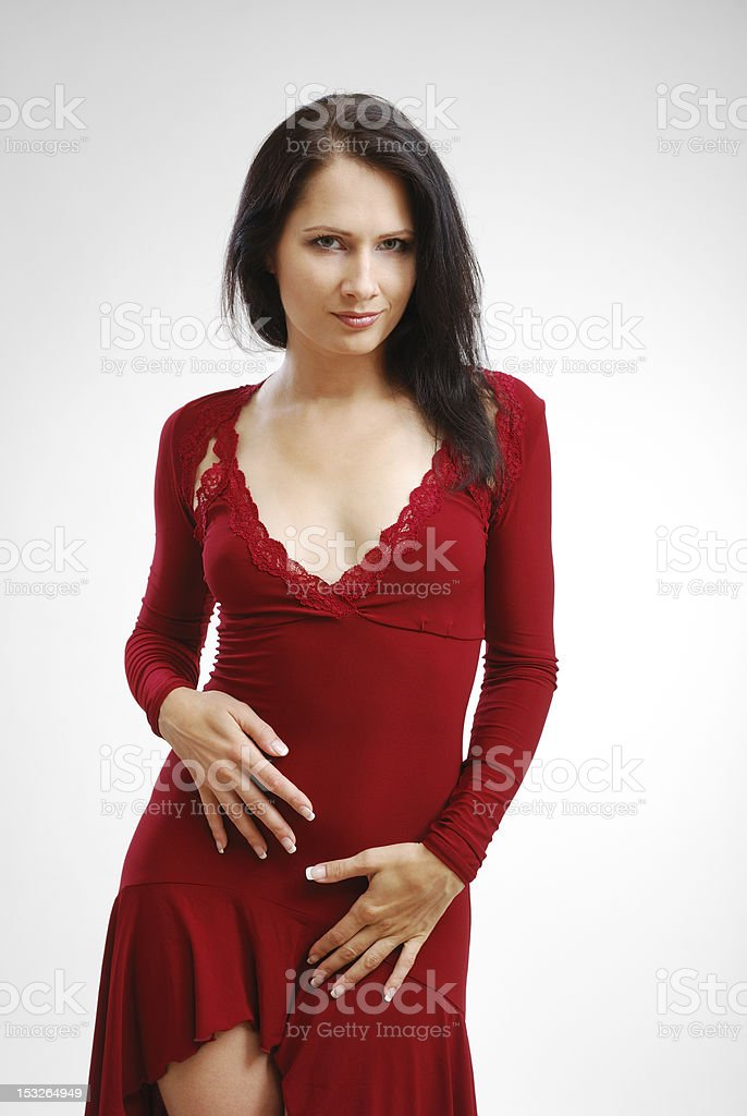 Young woman in cocktail dress stock photo