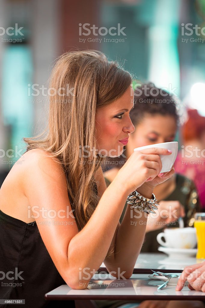 Young woman in coffee shop Close up of young woman drinking coffee in coffee shop. 20-24 Years Stock Photo