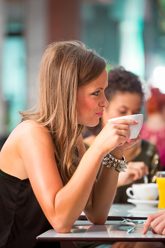Young Woman In Coffee Shop Stock Photo - Download Image Now