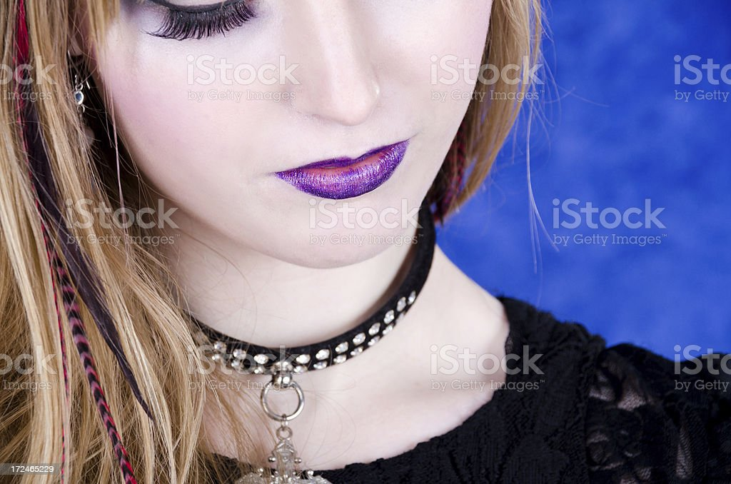 Young woman in collar looking down. royalty-free stock photo
