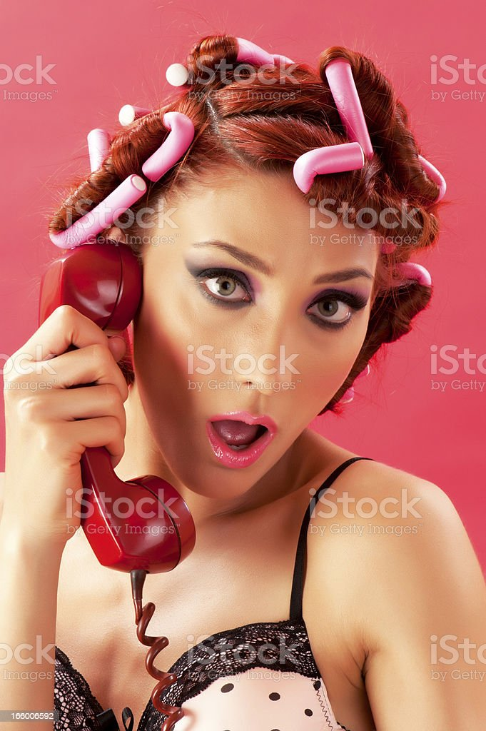 Young woman in curlers royalty-free stock photo