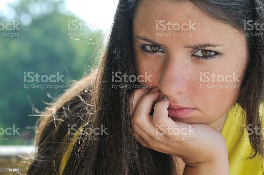 Young woman in depression outdoors royalty-free stock photo