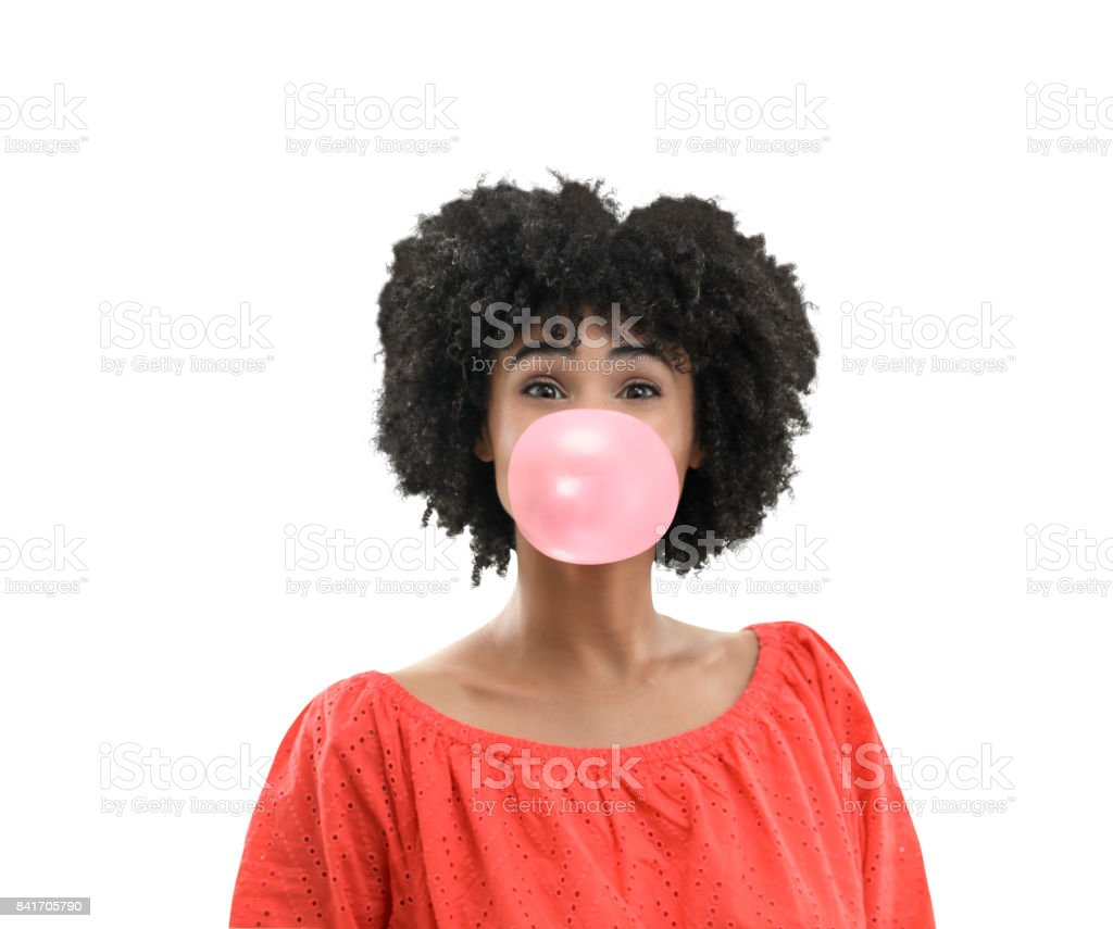 Young woman in dress blowing bubble stock photo