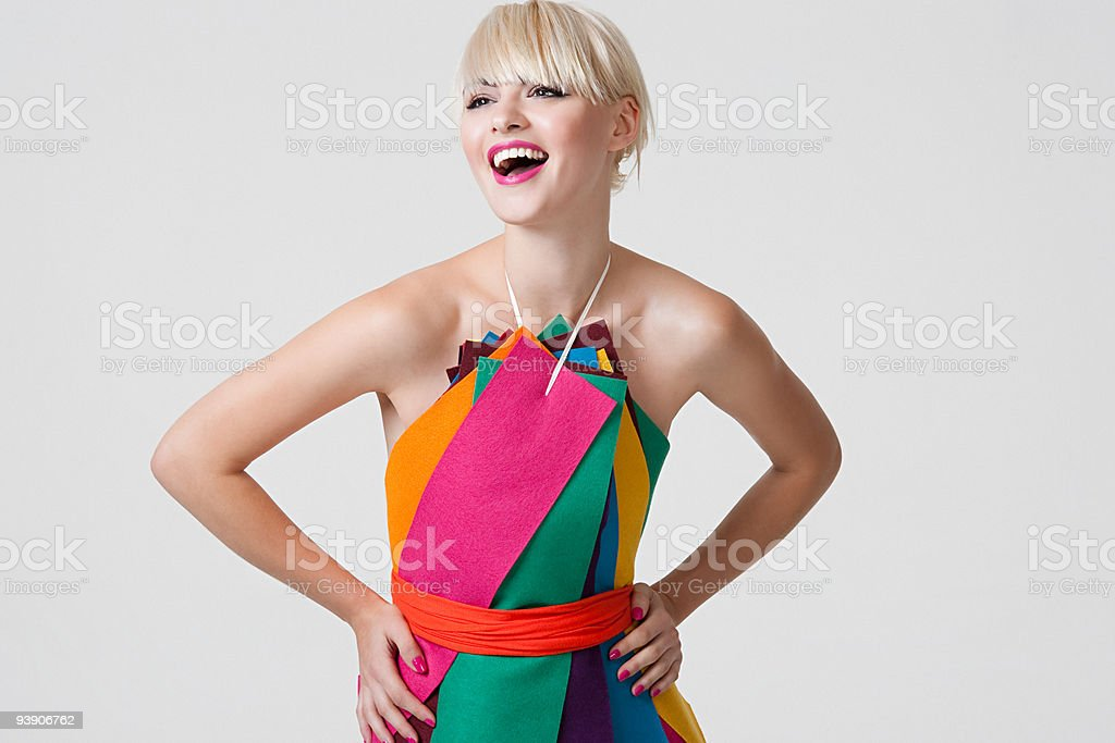 Young woman in dress made of coloured ribbons stock photo