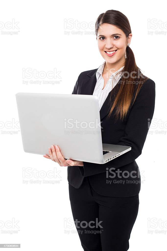 Young woman in formals posing with a laptop stock photo