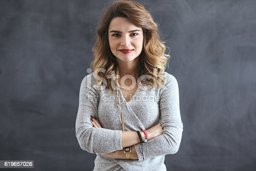 485083346 istock photo Young woman in front of blackboard 619657026