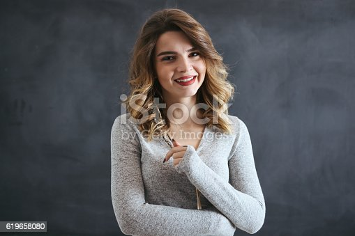 485083346 istock photo Young woman in front of blackboard 619658080