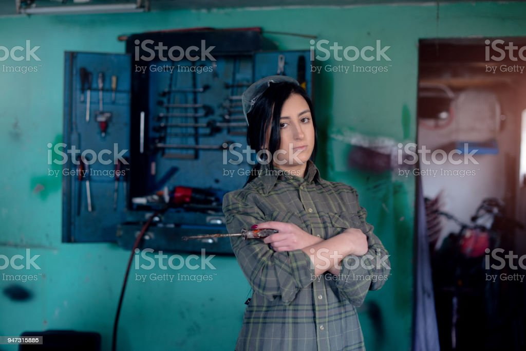 Youn woman is working in car service