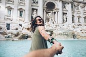 istock Young woman in front of Trevi fountain 858503812