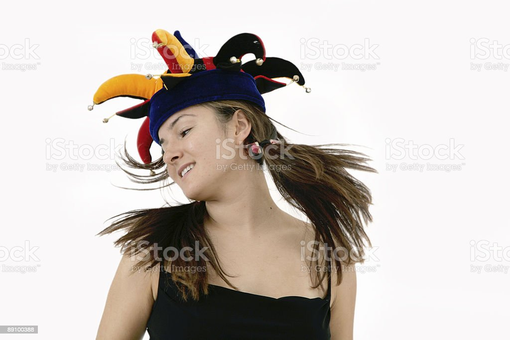 young woman in funky joker hat royalty-free stock photo