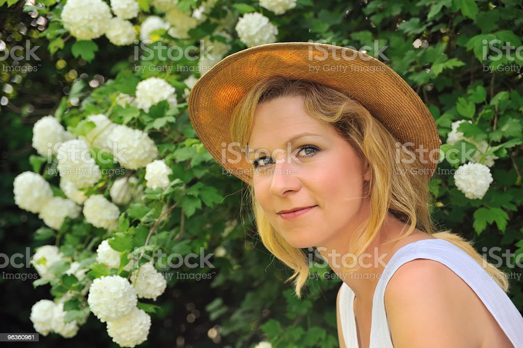 Young woman in garden royalty-free stock photo