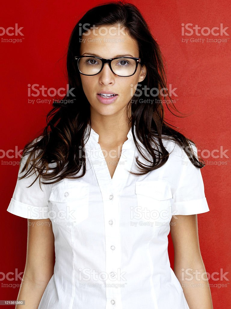 Young woman in glasses standing royalty-free stock photo