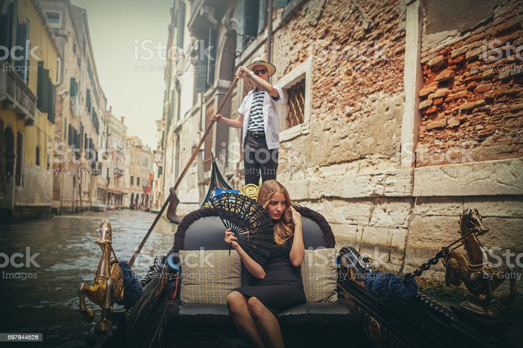 Young woman in gondola tour in Venice stock photo