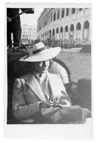 Young woman sitting in gondola,1935,Venice,Italy.