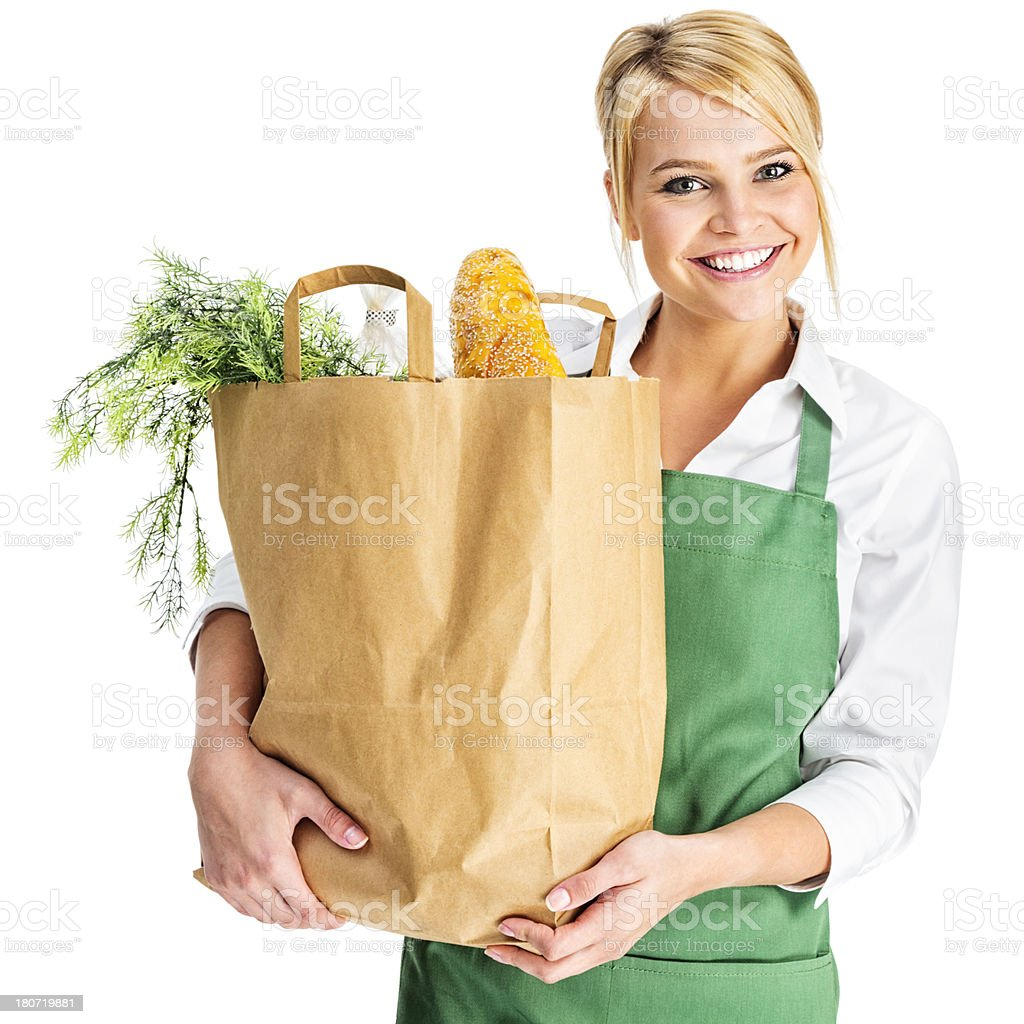 Young Woman in Green Apron with Sack of Groceries royalty-free stock photo