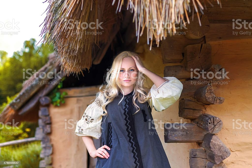 Young woman in grey ukrainian national costume - frontal view stock photo