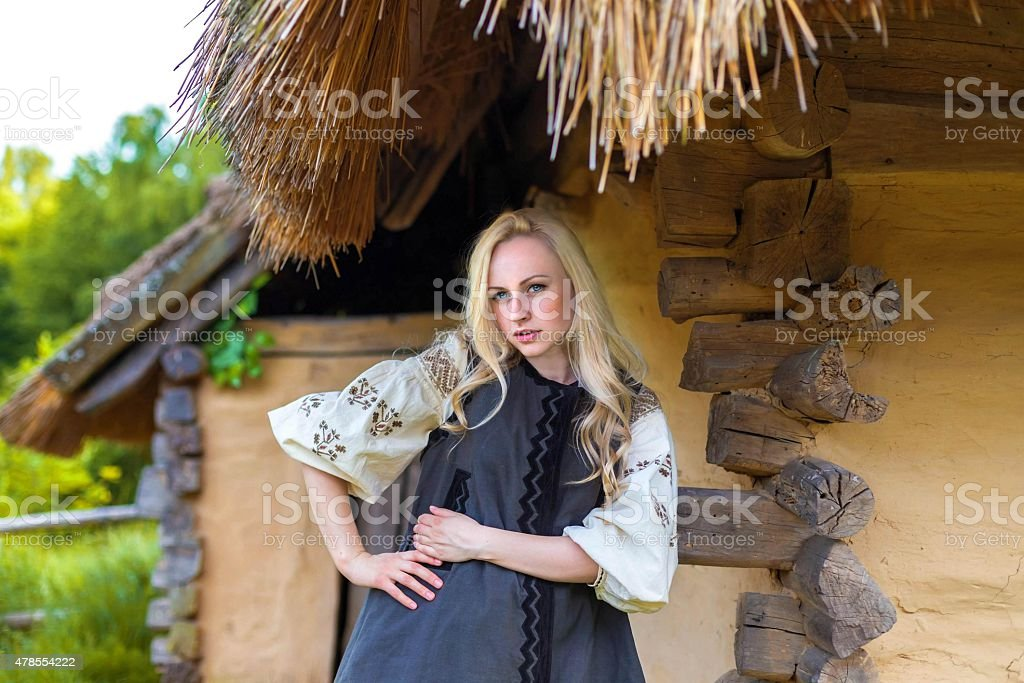 Young woman in grey ukrainian national costume stock photo