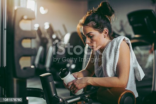 619088796 istock photo Young woman in gym 1081578760