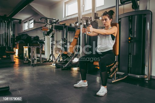 619088796 istock photo Young woman in gym 1081579062