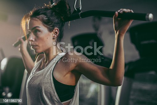 619088796 istock photo Young woman in gym 1081580750