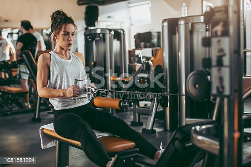 619088796 istock photo Young woman in gym 1081581224
