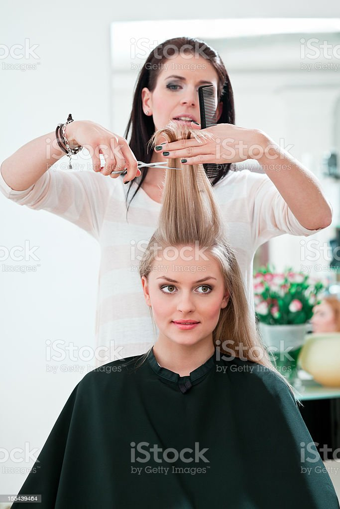 Young woman in hair salon stock photo