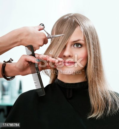 istock Young woman in hair salon 174785784