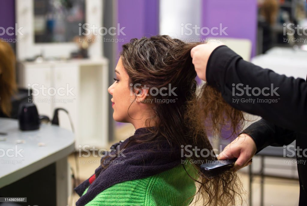 young woman in hairdresser salon