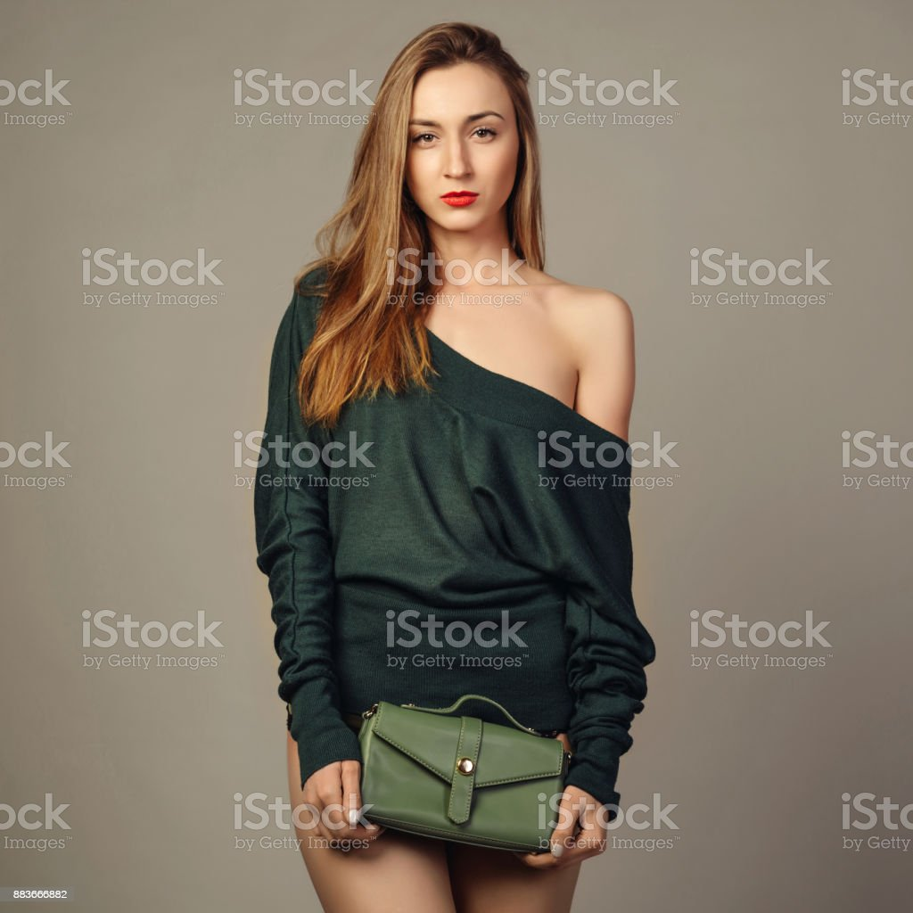 Young woman in hand small green trendy leather bag. stock photo