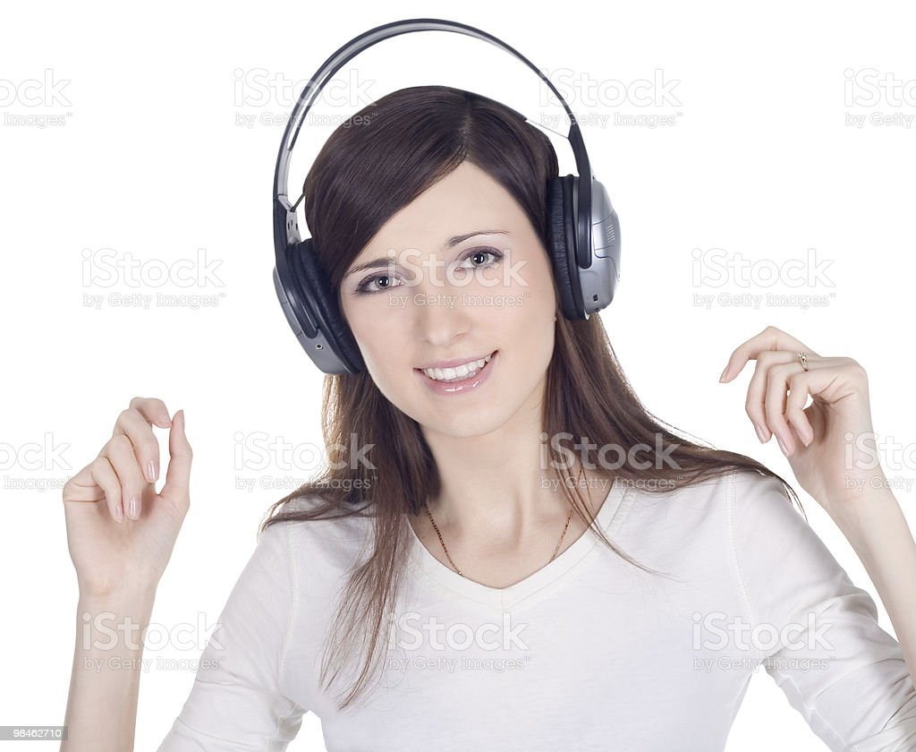 Young woman in headphones listening music royalty-free stock photo