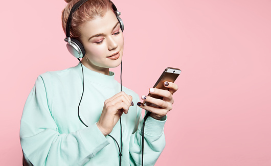 Young woman in headphones listening to music